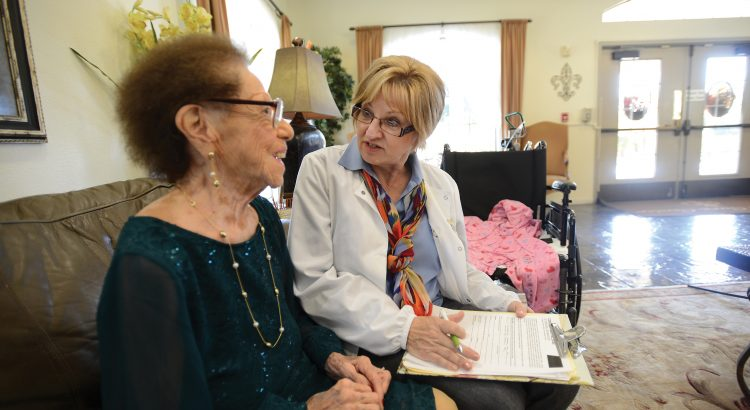 Hospice nurse with patient at nursing facility