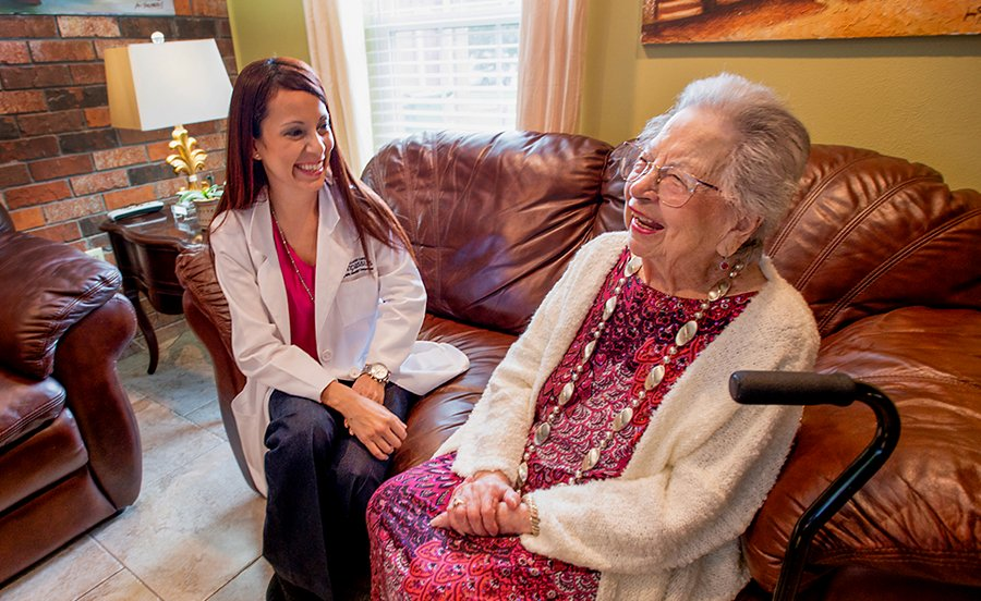 Hospice nurse with patient