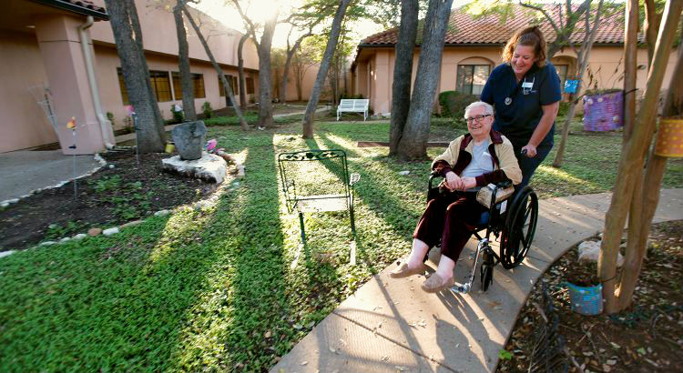 Hospice nurse with nursing home patient
